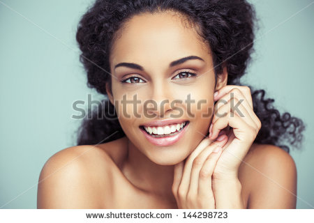 stock-photo-portrait-of-a-beautiful-young-african-woman-smiling-144298723