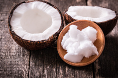 stock-photo-65154733-coconuts-and-oil-on-wooden-table